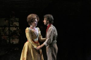 Musetta (Amanda Woodbury) and Marcello (Giorgio Caoduro) holding hands. Photo Credit: Ken Howard, LA Opera