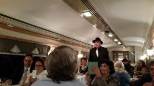 """Ken Duncan (as Butch Baranski) walks through the train aisle during """"Night Train to Murder."""""""