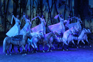 "Five women each perform a jaw-dropping balancing act atop a pair of horses in ""Odysseo."" Photo credit: Cavalia"