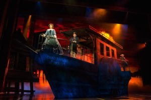"Laura Michelle Kelly as Anna (foreground) and Baylen Thomas as Captain Orton atop an incredible barge-like prop in Rodgers & Hammerstein's ""The King and I."" Photo credit: Matthew Murphy"