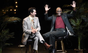 """""""Merrily We Roll Along"""" at the Wallis Annenberg Center for the Performing Arts. Directed by Michael Arden. Pictured (L-R): Aaron Lazar and Wayne Brady. Photo credit: Dan Steinberg for The Wallis."""