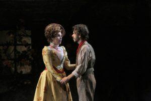 Musetta (Amanda Woodbury) and Marcello (Giorgio Caoduro) holding hands. Photo Credit: Ken Howard, LA Opera