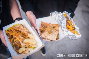 Guests display their food-truck-purchased food at a recent Street Food Cinema event. Photo credit: Street Food Cinema