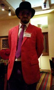 "Actor Tanner Herrmann as billionaire Reginald Sawbucks in The Murder Mystery Co.'s ""Midnight at the Masquerade"" show."