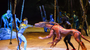 "A female Na'vi tries to fend off a puppeteered Viperwolf in Cirque du Soleil's ""Toruk - The First Flight."" Photo credit: Errisson Lawrence"