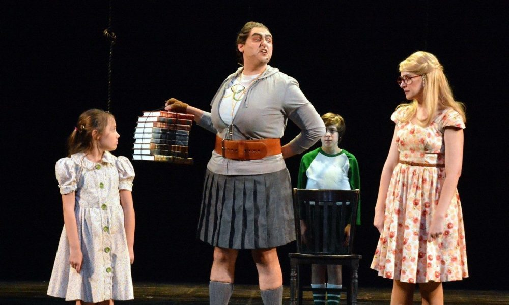 "Lucy Bollier, Nicholas Mongiardo-Cooper and Katie DeShan (with Marcello Silva in background) in 5-Star Theatricals' ""Matilda the Musical"" at the Kavli Theatre in Thousand Oaks, CA. Photo credit: Ed Krieger"