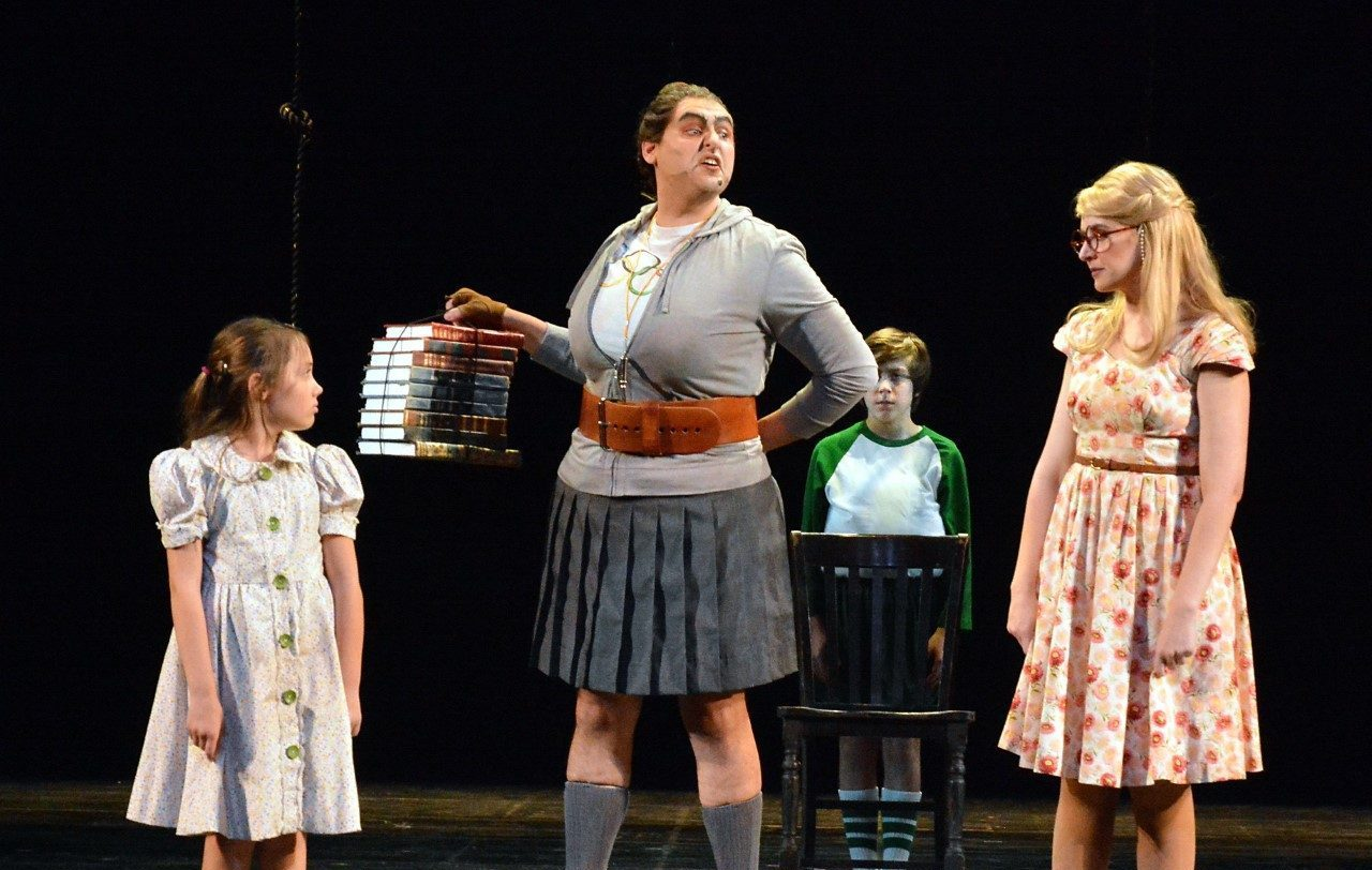 """Lucy Bollier, Nicholas Mongiardo-Cooper and Katie DeShan (with Marcello Silva in background) in 5-Star Theatricals' """"Matilda the Musical"""" at the Kavli Theatre in Thousand Oaks, CA. Photo credit: Ed Krieger"""